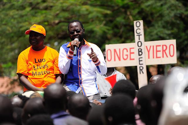 <p>Kisumu governor Anyang Nyongo addresses NASA supporters outside the IEBC (Independent Electoral and Boundaries Commission) offices during protests called for by NASA presidential candidate Odinga to boycott the upcoming elections on Oct. 24, 2017 in Kisumu, Kenya. (Photo: Kevin Midigo/AFP/Getty Images) </p>