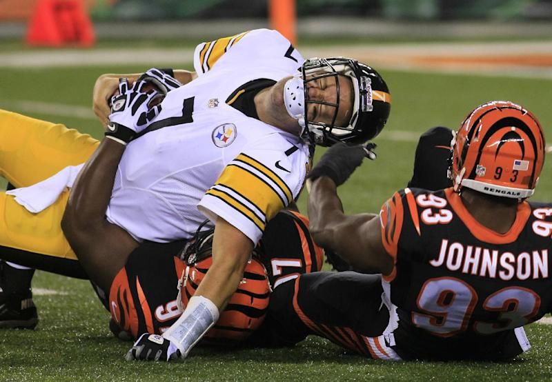 Pittsburgh Steelers quarterback Ben Roethlisberger (7) is sacked by Cincinnati Bengals defensive tackle Geno Atkins (97) and defensive end Michael Johnson (93) in the second half of an NFL football game, Monday, Sept. 16, 2013, in Cincinnati. (AP Photo/Tom Uhlman)
