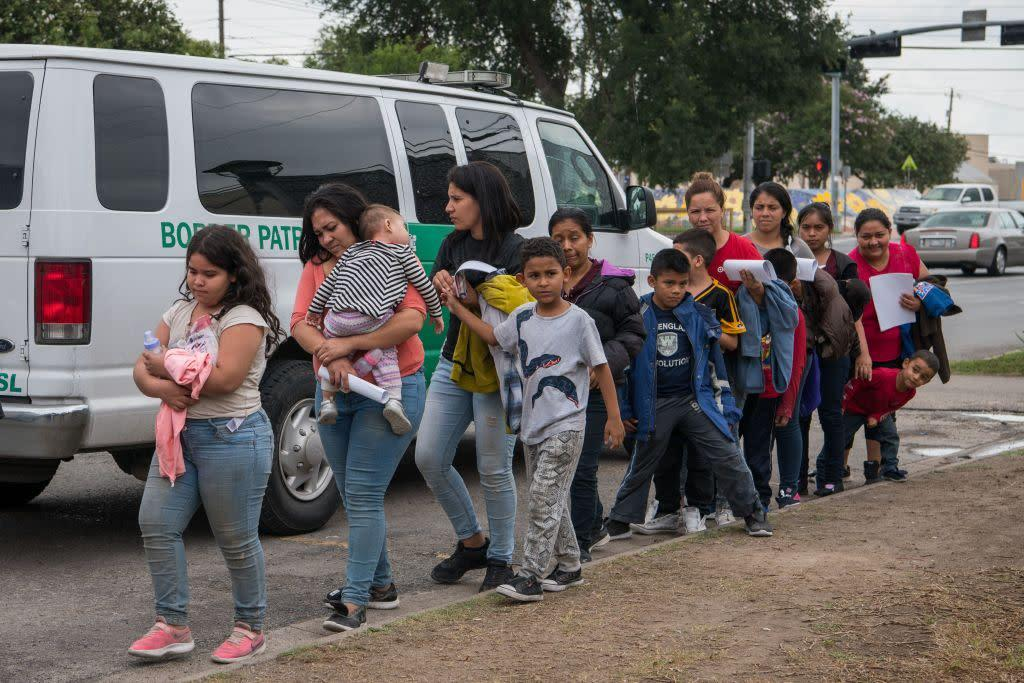 Central American migrant families arrive at a Catholic Charities respite center after being released from federal detention on June 12, 2019, in McAllen, Texas. | Loren Elliott—AFP/Getty Images