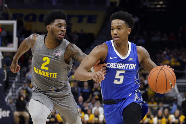 Creighton's Ty-Shon Alexander (5) drives to the basket against Marquette's Sacar Anim (2) during the second half of an NCAA college basketball game Tuesday, Feb. 18, 2020, in Milwaukee. (AP Photo/Aaron Gash)