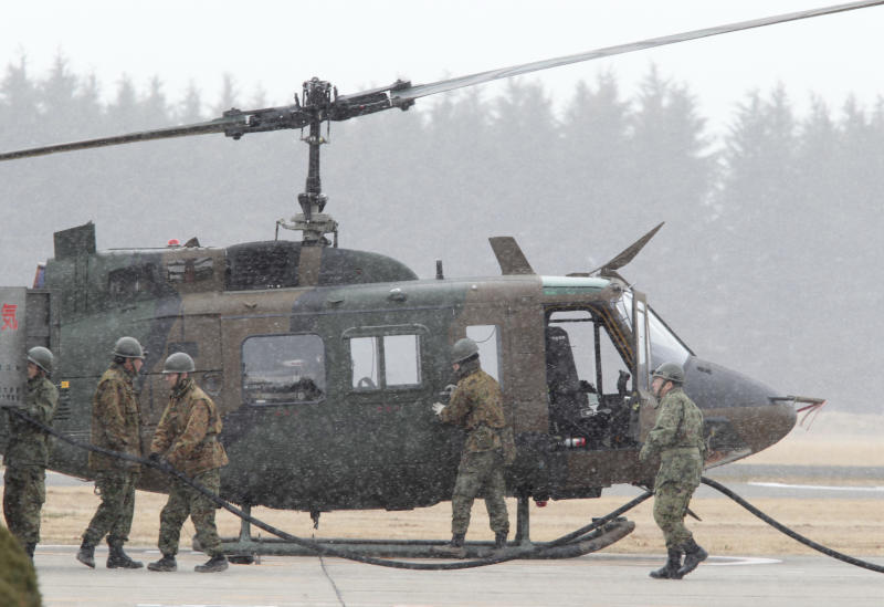 Japan Ground Self Defense Force refuel a helicopter at their base in Sendai, Japan, Thursday, March 17, 2011. (AP Photo/Mark Baker)