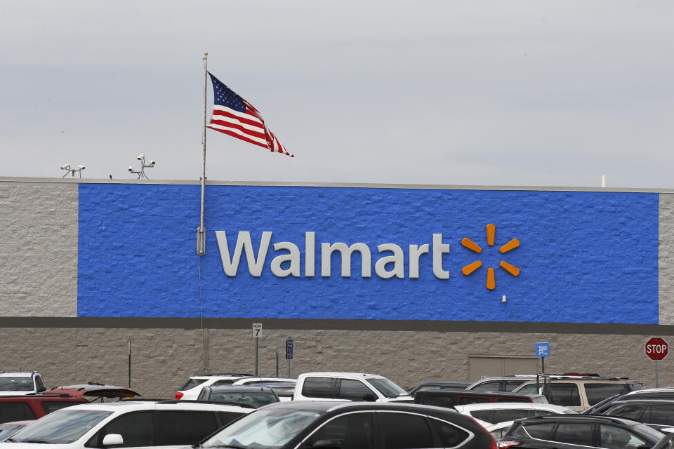 The signage is pictured in a Walmart store in Oklahoma City on Tuesday, August 4, 2020.  (AP Photo / Sue Ogrocki)
