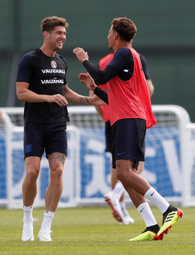 Soccer Football - World Cup - England Training - England Training Camp, Saint Petersburg, Russia - June 17, 2018 England's John Stones and Dele Alli during training REUTERS/Lee Smith