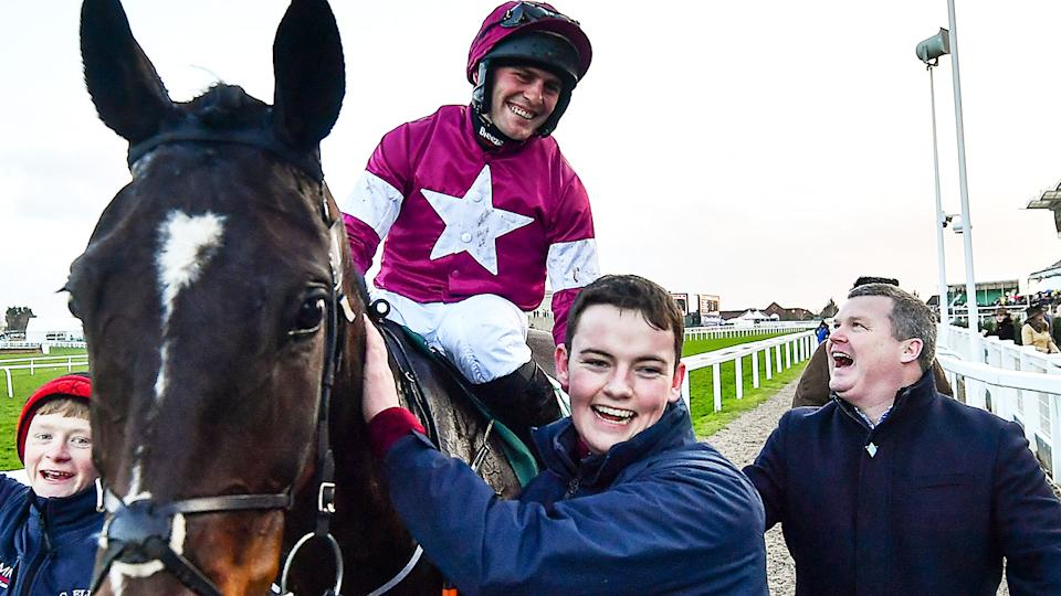 Rob James, pictured here with trainer Gordon Elliott at the Cheltenham Racing Festival.