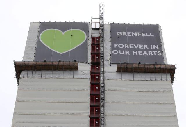 Grenfell Tower as seen from the Grenfell Memorial Wall in the grounds of Kensington Aldridge Academy