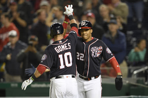 Washington Nationals' Yan Gomes (10) celebrates his two-run home run with Juan Soto (22) during the fourth inning of a baseball game against the San Diego Padres, Friday, April 26, 2019, in Washington. (AP Photo/Nick Wass)
