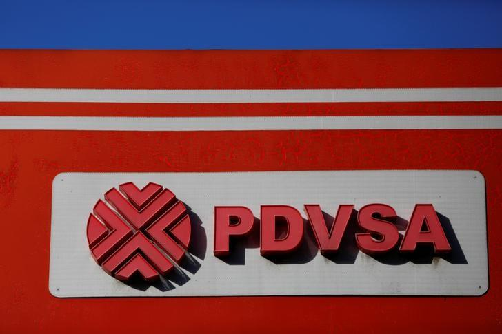 The logo of the Venezuelan state oil company PDVSA is seen at a gas station in Caracas