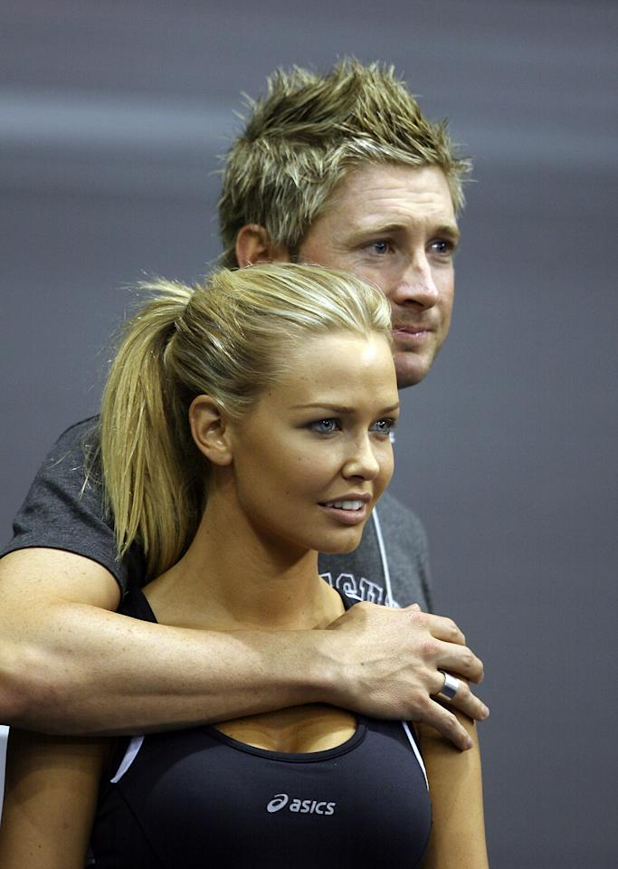 ADELAIDE, AUSTRALIA - DECEMBER 01:  Lara Bingle with Michael Clark watch the action during the Gerard McCabe Jewellers Celebrity Tennis Challenge at the Adelaide Entertainment Centre on December 1, 2007 in Adelaide, Australia. The event, now in its 14th year, aims to raise funds to benefit the research work of the Bone Growth Foundation as it strives to improve the quality of life of children suffering bone growth problems.  (Photo by Simon Cross/Getty Images)