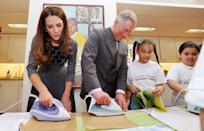 """<p>Kate Middleton and Prince Charles prove that they have what it takes to rival the <a href=""""https://www.housebeautiful.com/lifestyle/a28858358/queen-elizabeth-hiring-assistant-housekeeper/"""" rel=""""nofollow noopener"""" target=""""_blank"""" data-ylk=""""slk:housekeepers at Buckingham Palace"""" class=""""link rapid-noclick-resp"""">housekeepers at Buckingham Palace</a>, as they both man an iron in 2012. They're not ironing clothes though. They're making crafts with kids at a charity event.</p>"""
