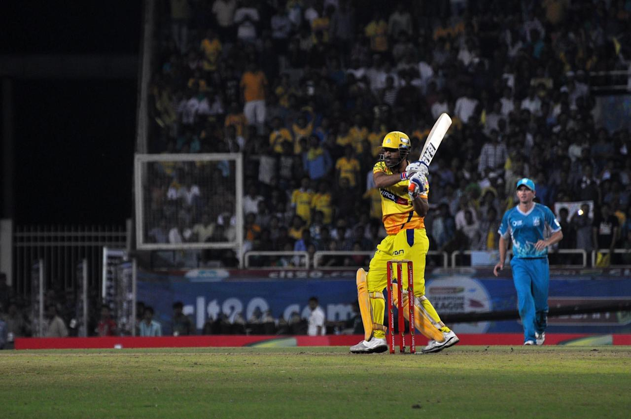 Chennai Super Kings batsman MS Dhoni plays a shot during match against Brisbane Heat during CLT20 Match at JSCA Stadium in Ranchi on Sept. 28, 2013. (Photo: IANS)