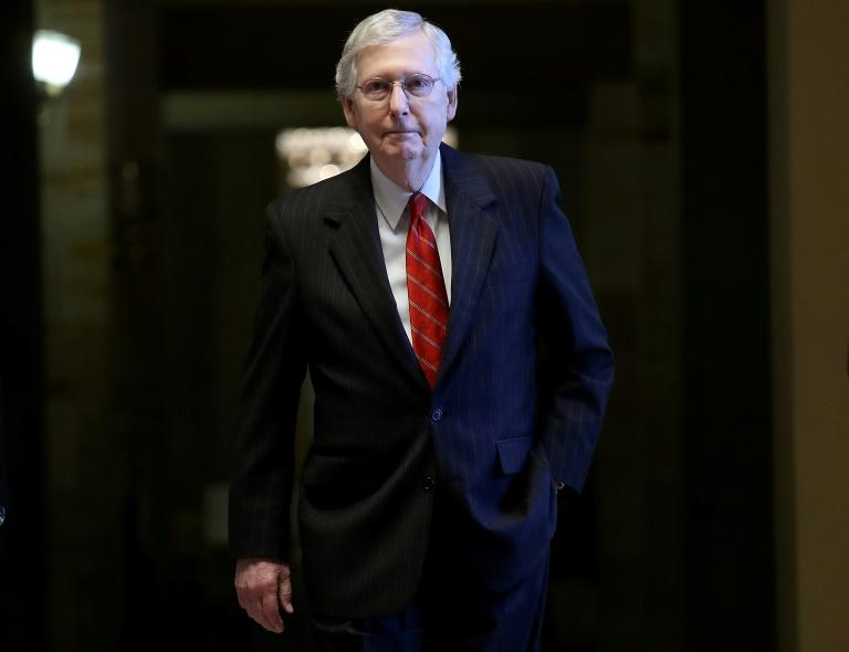 Under pressure: US mayors demand Republican Senate leader Mitch McConnell recall the Senate from vacation to pass tough gun control legislation already approved in the Democrat-led House of Represenatives (AFP Photo/WIN MCNAMEE)
