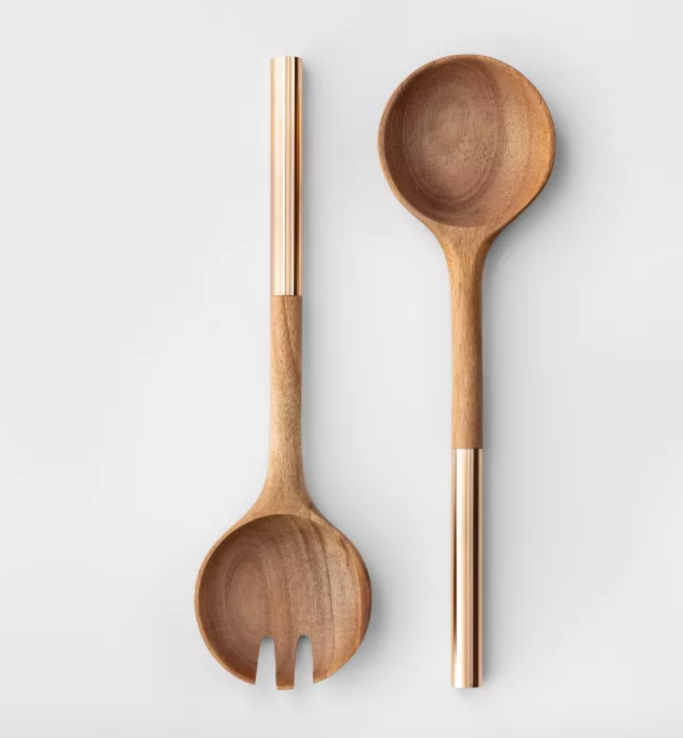 """<p><a class=""""link rapid-noclick-resp"""" href=""""https://www.target.com/p/cravings-by-chrissy-teigen-2pc-acacia-wood-salad-serving-set/-/A-53699779"""" rel=""""nofollow noopener"""" target=""""_blank"""" data-ylk=""""slk:BUY NOW"""">BUY NOW</a> <em><strong>$10, target.com</strong></em></p><p>One of the best-selling items from Chrissy Teigen's collaboration with Target is her two-piece set of wooden salad serving utensils, for obvious reasons.</p>"""