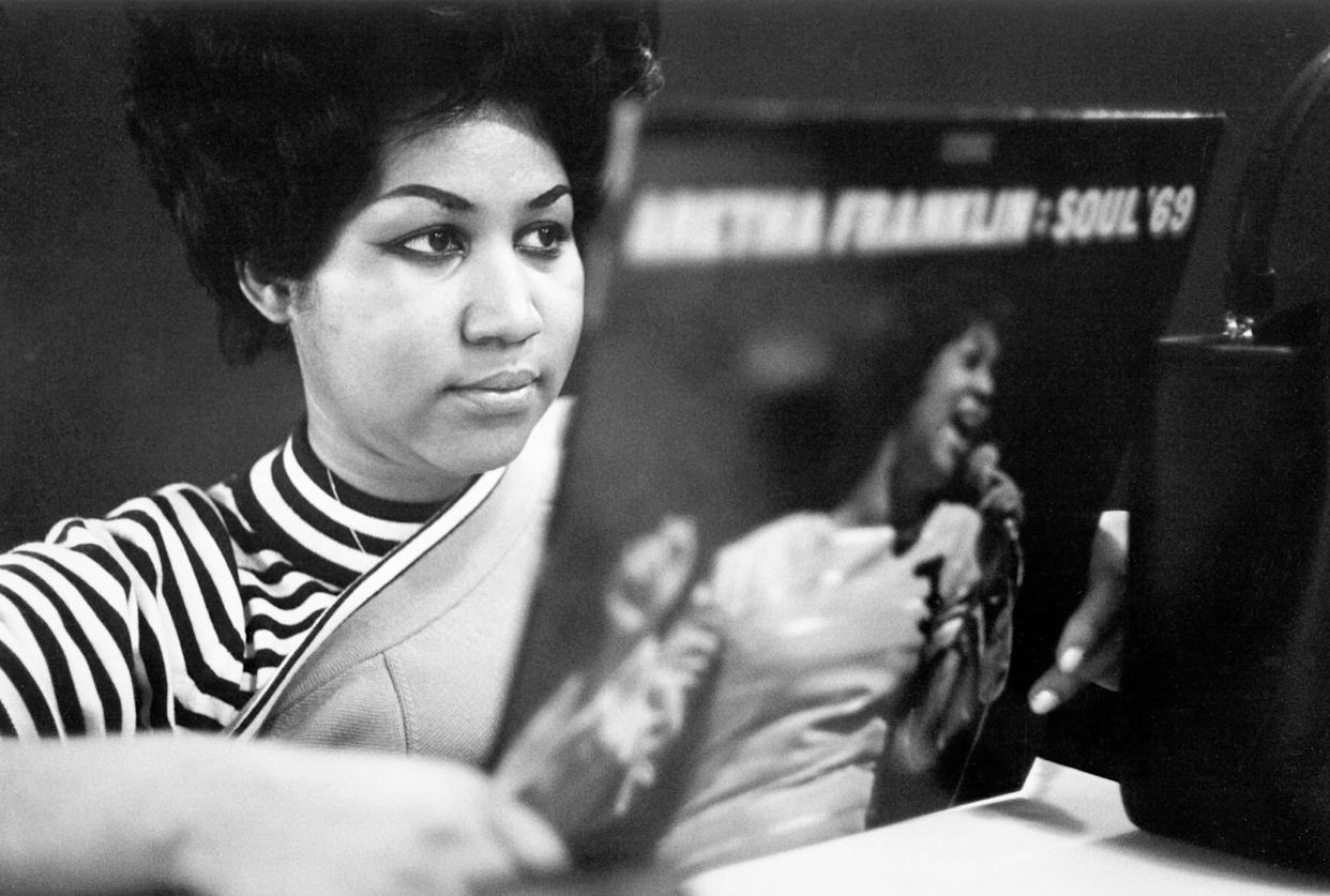 """Reviewing a copy of her album """"Aretha Franklin -- Soul '69"""" at Atlantic Records studios in 1969 in New York City."""