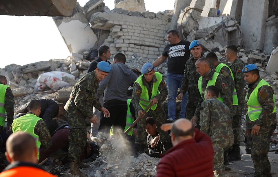 Military personnel and locals work near a damaged building in Thumane, after an earthquake shook Albania, November 26, 2019. (Photo: Florion Goga/Reuters)