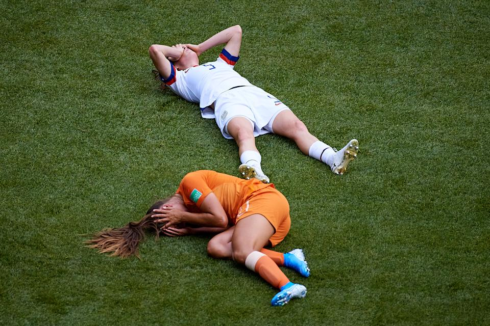 Lieke Martens (L) of Netherlands and Kelley O'Hara of the USA lay down on the pitch after knocking heads during the 2019 FIFA Women's World Cup France Final match between The United States of America and The Netherlands. Both players would return to the field just minutes later. (Photo by David Aliaga/MB Media/Getty Images)