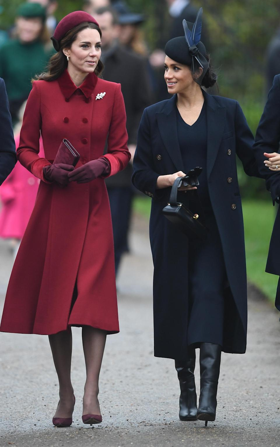 Kate and Meghan looked festive as they walked to the service [Photo: PA]