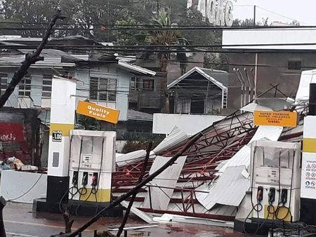 A damaged petrol station is seen as Typhoon Mangkhut hits Philippines, Laoag, Philippines September 15, 2018 in this still image obtained from a social media video. PHILIPPINE RED CROSS/via REUTERS