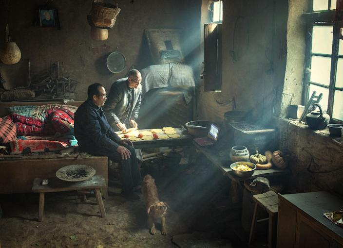 <p>Earth kiln: Two brothers live in a traditional yaodong ('kiln cave'), carved into a hillside on the Loess Plateau in central China. The earth-lined walls have good insulating properties, enabling residents to survive cold winters, Nov. 11, 2017.<br>The yaodong is one of the earliest housing types in China, dating back more than 2,000 years. The Loess Plateau in the upper and middle reaches of the Yellow River, is approximately the size of France.The loess soil—fine, mineral-rich, wind-blown silt, accumulated over centuries—is hundreds of meters thick in some places, and the numbers of yaodong run into millions. The loess not only keeps the dwellings warm in winter, but also cool in summer. The brothers, who are both unmarried, have lived in this yaodong for most of their lives. (Photo: Li Huaifeng) </p>