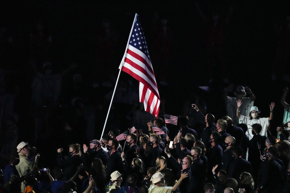 Athletes from the United States prepare to enter during the opening ceremony in the Olympic Stadium at the 2020 Summer Olympics, Friday, July 23, 2021, in Tokyo, Japan. (AP Photo/Charlie Riedel)