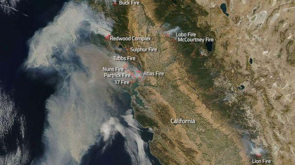 PHOTO: Northern California wildfires burning as seen from space, Oct. 9, 2017. by NASA satellites. (NASA)