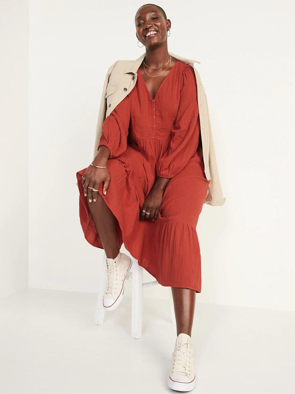<p>This <span>Old Navy Long-Sleeve Fit &amp; Flare Tiered Midi Dress</span> ($50) is modest and cool. The burnt orange hue is everywhere right now.</p>
