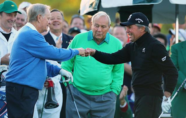 Arnold Palmer, center, watches as Jack Nicklaus, left, and Gary Player touch fists after Palmer hit his ceremonial drive on the first tee during the first round of the Masters golf tournament Thursday, April 10, 2014, in Augusta, Ga. (AP Photo/Atlanta Journal-Constitution, Curtis Compton) MARIETTA DAILY OUT; GWINNETT DAILY POST OUT; LOCAL TV OUT; WXIA-TV OUT; WGCL-TV OUT