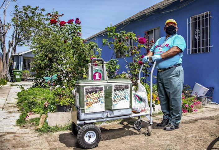 Faustino Martinez with a pushcart.