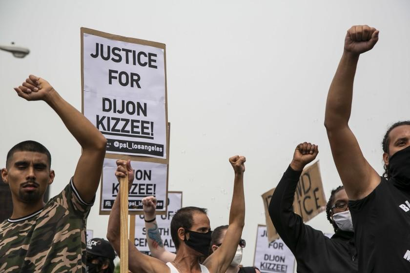 SOUTH LOS ANGELES, CA - SEPTEMBER 12: Protesters raise their fists as they march down Vermont Ave. during a protest calling for justice and in honor of Dijon Kizzee on Saturday, Sept. 12, 2020 in South Los Angeles, CA. Kizzee was killed by LA Sheriff's Deputies on Aug. 31 in the Westmont area and protests calling for the accountability of LASD have continued for the past week. (Josie Norris / Los Angeles Times)
