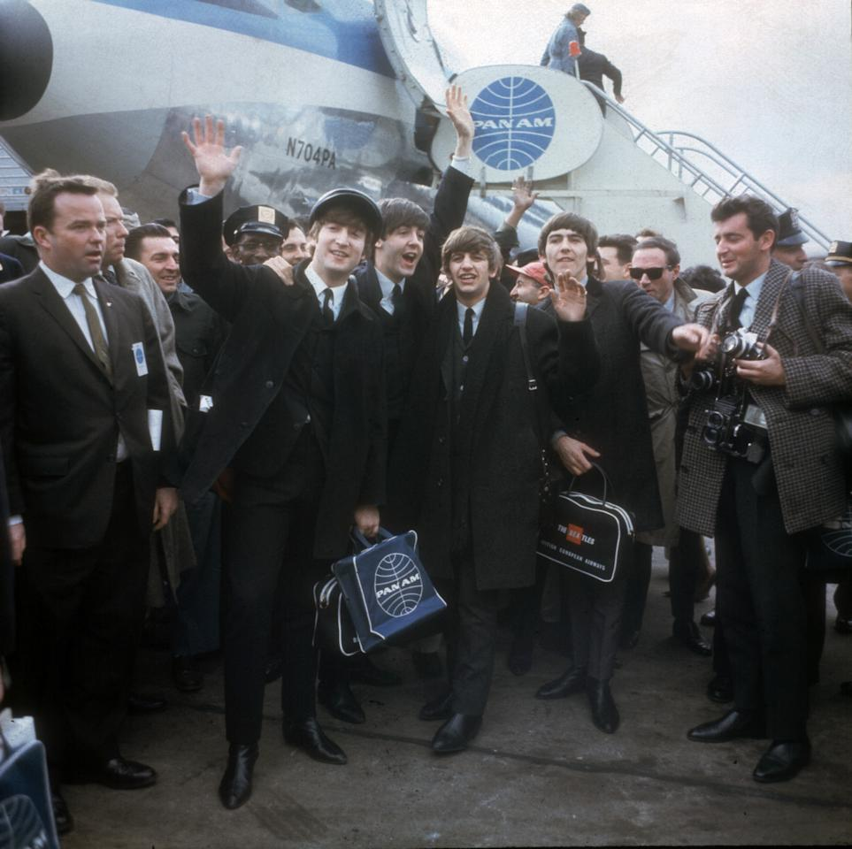 FILE - In this Feb. 7, 1964 file photo, the Beatles arrive in New York for their first U.S. appearances. From left are: John Lennon, Paul McCartney, Ringo Starr and George Harrison. McCartney turned 70 Monday June 18, 2012. (AP Photo/File)