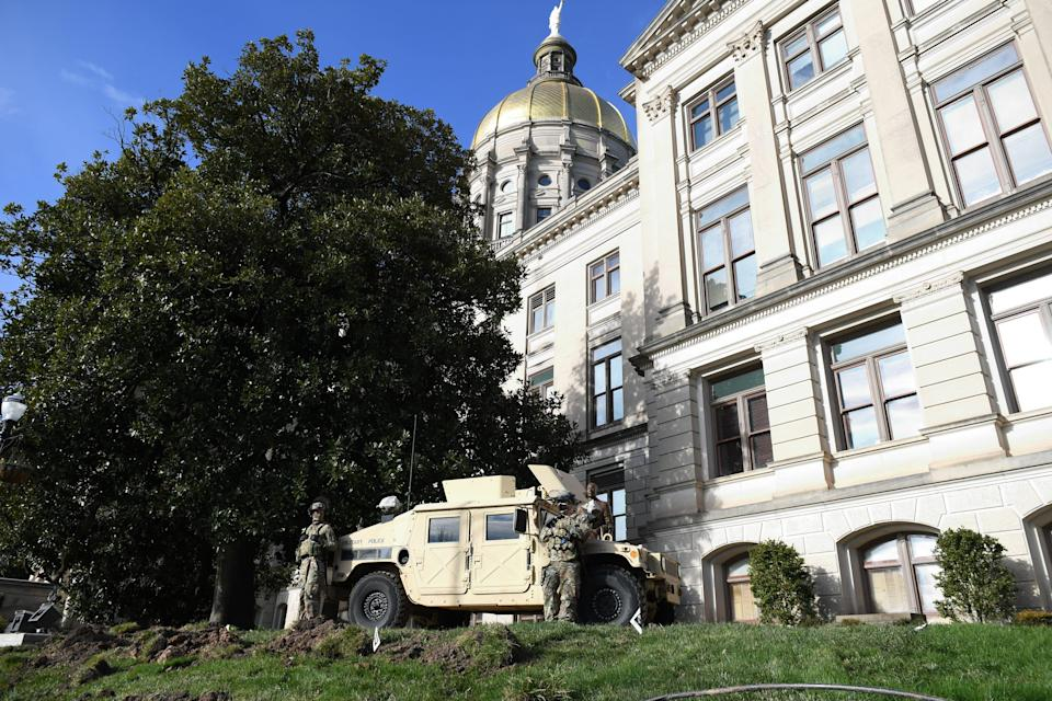 The Georgia state capitol in Atlanta, Ga., is heavily protected by the National Guard on Sunday, Jan. 17, 2021.