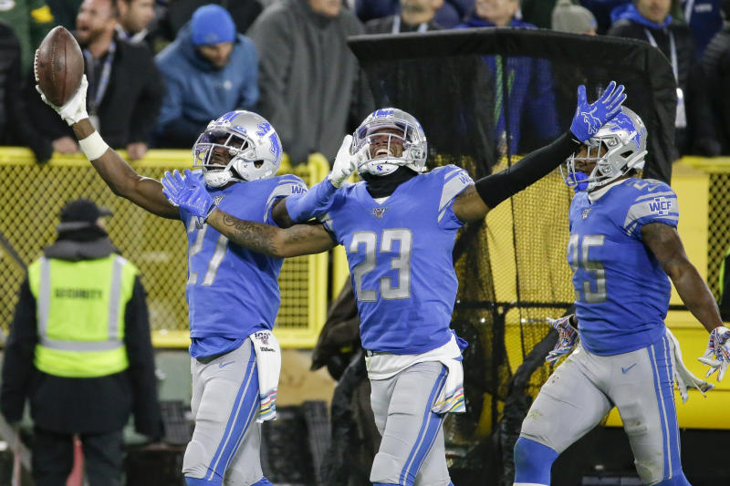 Detroit Lions cornerback Justin Coleman (27) celebrates an interception against the Green Bay Packers with teammates Darius Slay (23) and Will Harris (25) during the second half of an NFL football game Monday, Oct. 14, 2019, in Green Bay, Wis. (AP Photo/Mike Roemer)