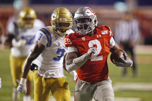 Utah running back Zack Moss (2) leaves UCLA defensive back Rayshad Williams (3) behind on his way to a touchdown during the first half of an NCAA college football game Saturday, Nov. 16, 2019, in Salt Lake City. (AP Photo/Rick Bowmer)