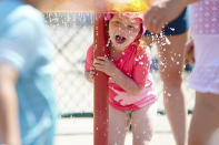 Raegan Sack, 4, cools off at Max Patterson Park during a record setting heat wave in Gladstone, Ore., Sunday, June 27, 2021. Yesterday set a record high for the day with more records expected today. (AP Photo/Craig Mitchelldyer)