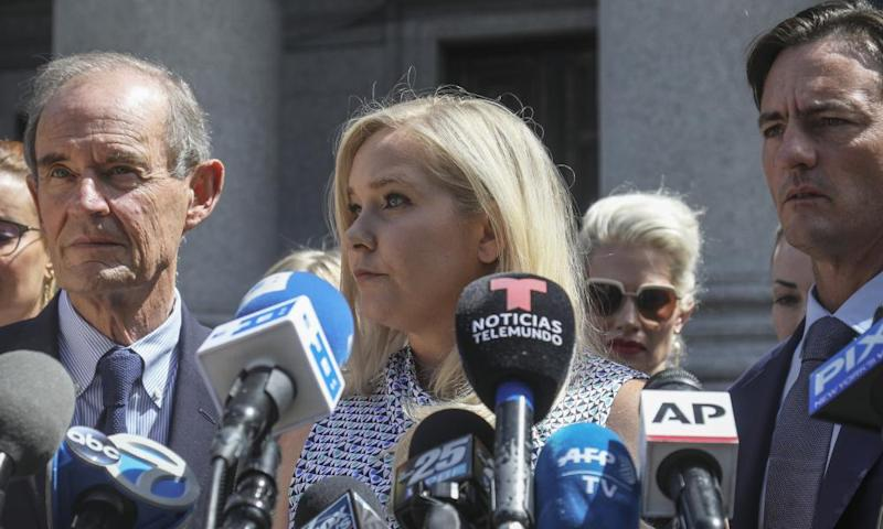 Virginia Roberts Giuffre (centre) holds a press conference in August 2019