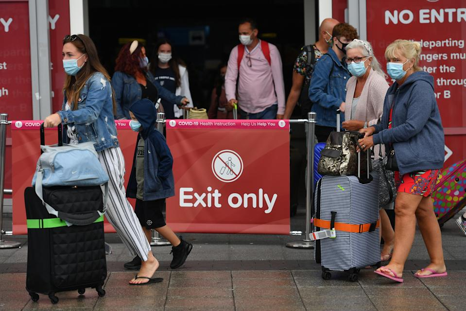 Passengers arriving at Birmingham Airport, as people arriving into England from holidays in Spain have been told they must quarantine when they return home. (Photo by Jacob King/PA Images via Getty Images)