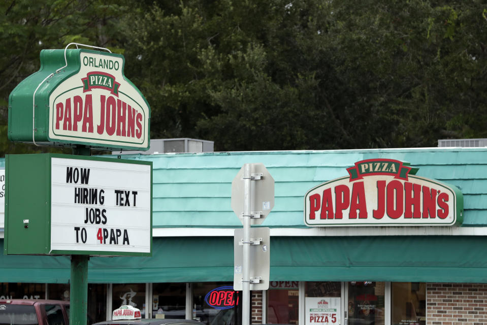 In this Monday, Nov. 4, 2019 photo a job posting for a Papa John's Pizza restaurant is seen in Orlando, Fla. (AP Photo/John Raoux)