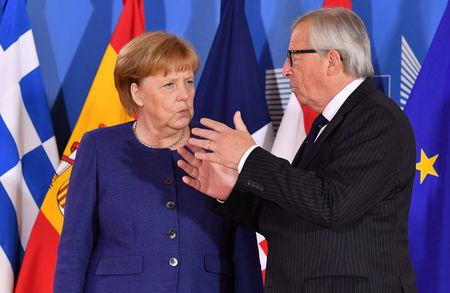 European Commission President Jean-Claude Juncker speaks with German Chancellor Angela Merkel during an informal EU summit on migration at EU headquarters in Brussels, June 24, 2018. Geert Vanden Wijngaert/Pool via Reuters