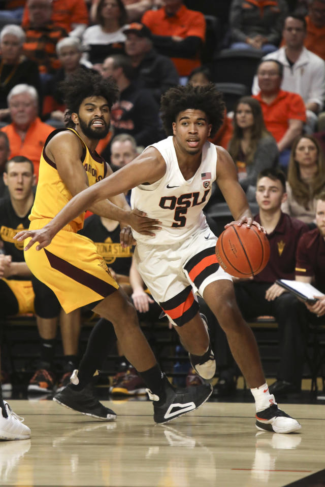 Oregon State's Ethan Thompson (5) slips past Arizona State's Remy Martin (1) during the first half of an NCAA college basketball game in Corvallis, Ore., Sunday, March 3, 2019. (AP Photo/Amanda Loman)