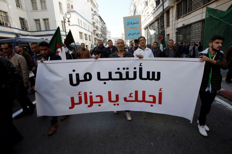 Pro-government supporters rally in Algeria to back planned elections