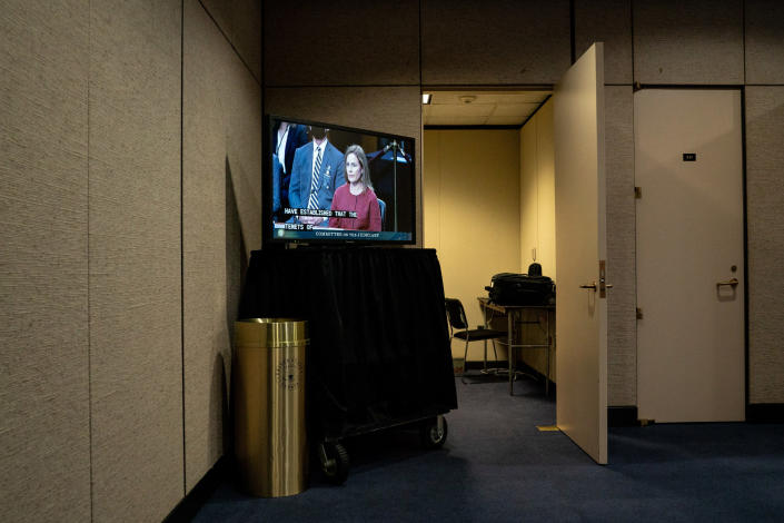 A live feed of Supreme Court confirmation hearings for Judge Amy Coney Barrett, on a video screen at the Hart Senate Office Building in Washington, Oct. 13, 2020. (Anna Moneymaker/The New York Times)