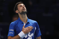 Novak Djokovic of Serbia celebrates winning match point against Diego Schwartzman of Argentina during their singles tennis match at the ATP World Finals tennis tournament at the O2 arena in London, Monday, Nov. 16, 2020. (AP Photo/Frank Augstein)