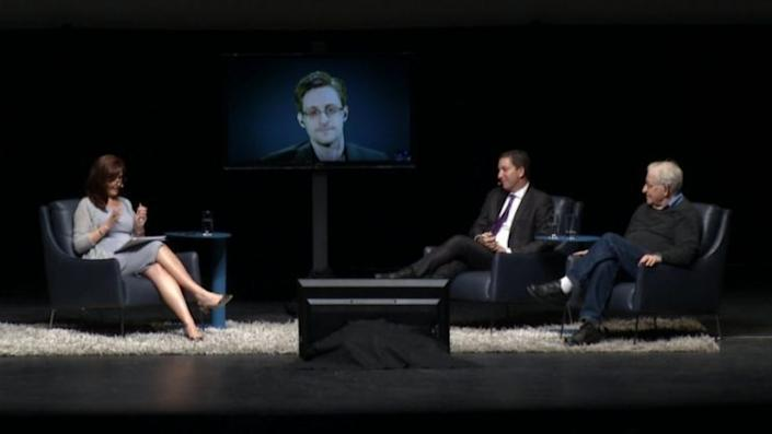Snowden appearing with Glenn Greenwald and Noam Chomsky at the University of Arizona on March 25. (Photo: University of Arizona)