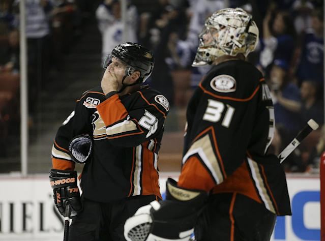 Anaheim Ducks' Francois Beauchemin, left, and goalie Frederik Andersen, of Denmark, look at the scoreboard after Toronto Maple Leafs' Tyler Bozak scored during the first period of an NHL hockey game on Monday, March 10, 2014, in Anaheim, Calif. (AP Photo/Jae C. Hong)
