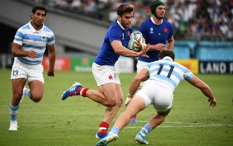 France's wing Damian Penaud (C) runs to evade Argentina's wing Ramiro Moyano (R) during the Japan 2019 Rugby World Cup Pool C match between France and Argentina at the Tokyo Stadium in Tokyo on September 21, 2019. - Credit: Getty Images