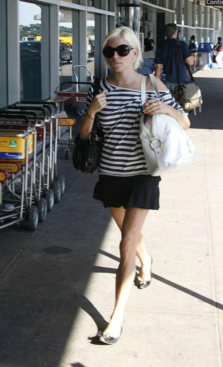 <p>Sienna Miller arrives at LaGuardia Airport in New York City in a black and white outfit in 2006. </p>