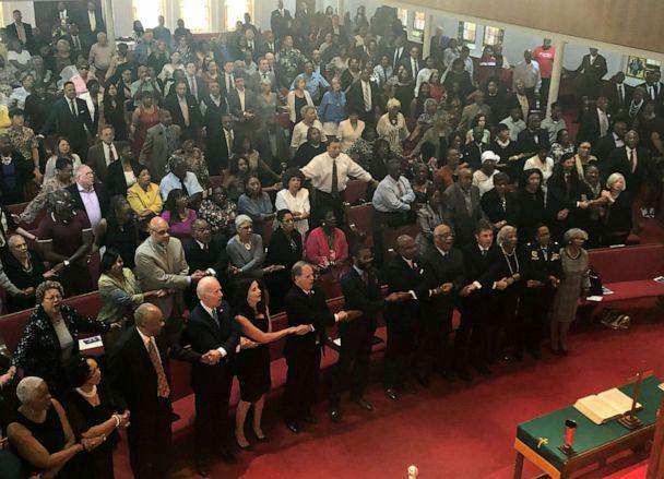 PHOTO:Presidential candidate and former Vice President Joe Biden, left front, joins the congregation of 16th Street Baptist Church in Birmingham, Alabama, as they sing 'We Shall Overcome'€ at Sunday worship, Sept. 15, 2019. (Bill Barrow/AP)