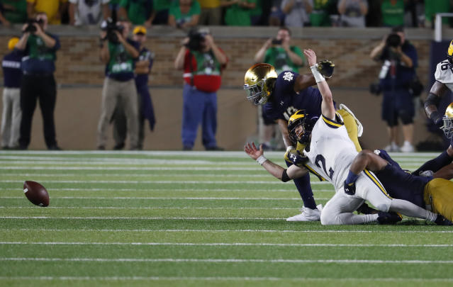 Michigan quarterback Shea Patterson (2) fumbles the ball against Notre Dame in the second half of an NCAA football game in South Bend, Ind., Saturday, Sept. 1, 2018. Notre Dame won 24-17. (AP Photo/Paul Sancya)