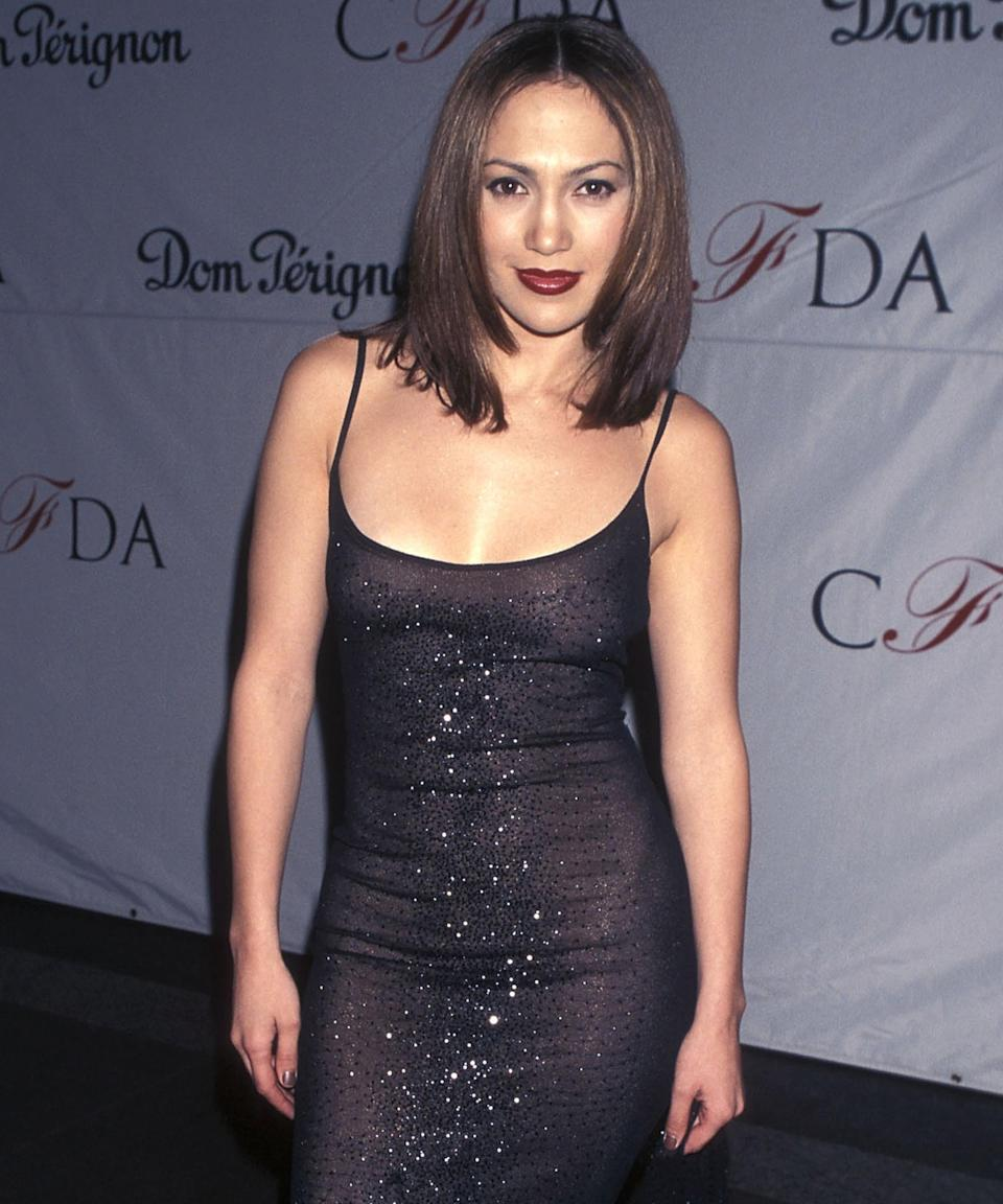 """<h3>1998</h3><br>J.Lo is hardly ever without lengthy extensions these days, but in 1998, she attended the 17th Annual CFDA Awards with a choppy, layered cut that you could easily take to your stylist today.<span class=""""copyright"""">Photo: Ron Galella Collection/Getty Images.</span>"""