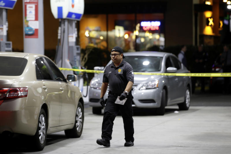 Garden Grove police work the scene of a stabbing in Garden Grove, Calif., Wednesday, Aug. 7, 2019. A man killed multiple people and wounded others in a string of robberies and stabbings in California's Orange County before he was arrested, police said Wednesday. (AP Photo/Alex Gallardo)