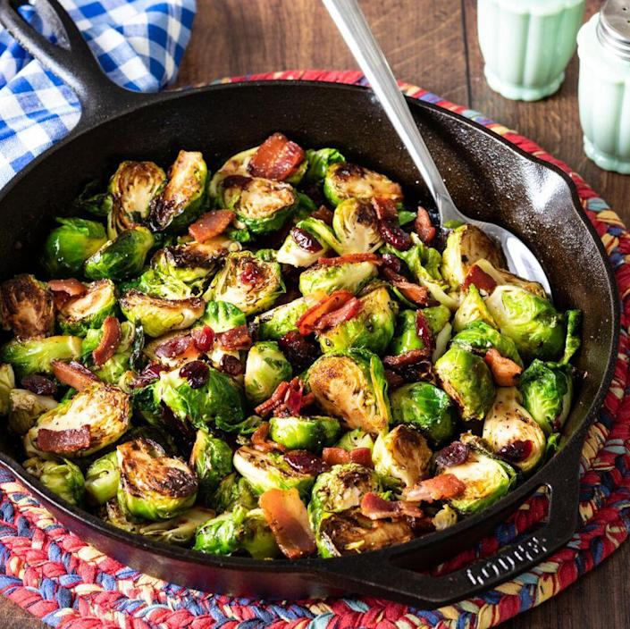 """<p>The sweet and salty combination of maple syrup and bacon transforms simple skillet Brussels sprouts into something amazing! Even picky eaters will love them! </p><p><a href=""""https://www.thepioneerwoman.com/food-cooking/recipes/a37242804/maple-bacon-brussels-sprouts-recipe/"""" rel=""""nofollow noopener"""" target=""""_blank"""" data-ylk=""""slk:Get the recipe."""" class=""""link rapid-noclick-resp""""><strong>Get the recipe.</strong></a></p>"""